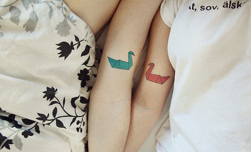 Matching swan tattoos