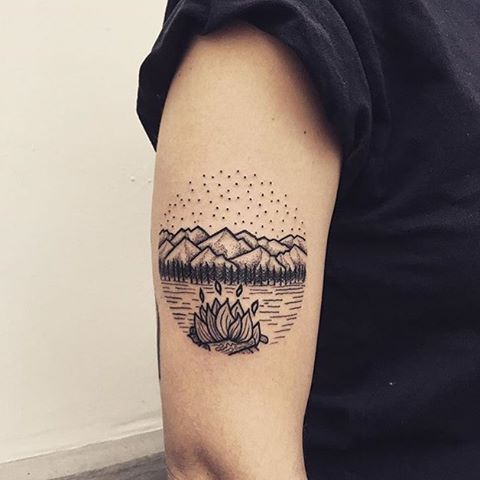 Mountains tattoo on the arm