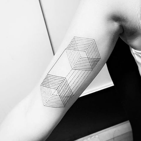Optical illusion geometric tattoo