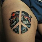 Peace sign tattoo on the thigh