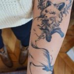 Realistic fox tattoo on the arm