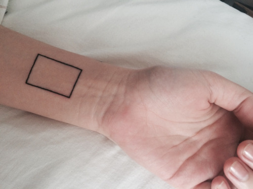 Rectangle tattoo on the wrist