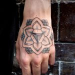 Simple lotus flower tattoo on the hand