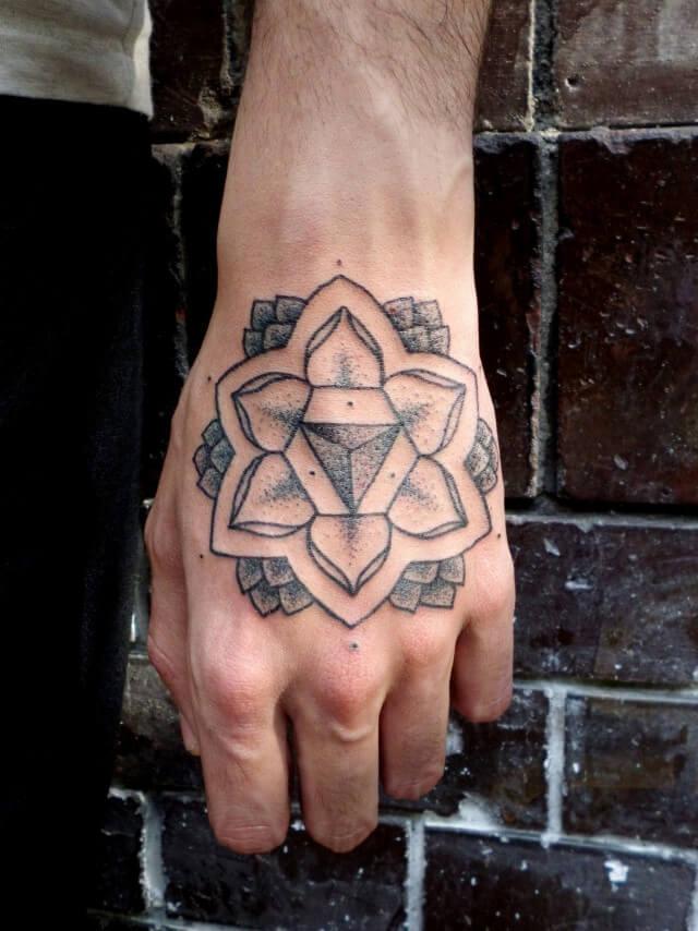 Simple lotus flower tattoo on the hand