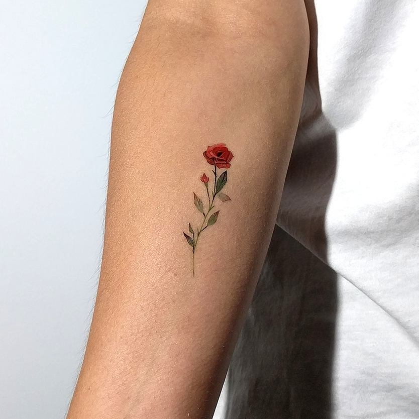 Small rose tattoo on the inner arm