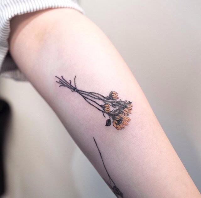 Sunflower bouquet tattoo