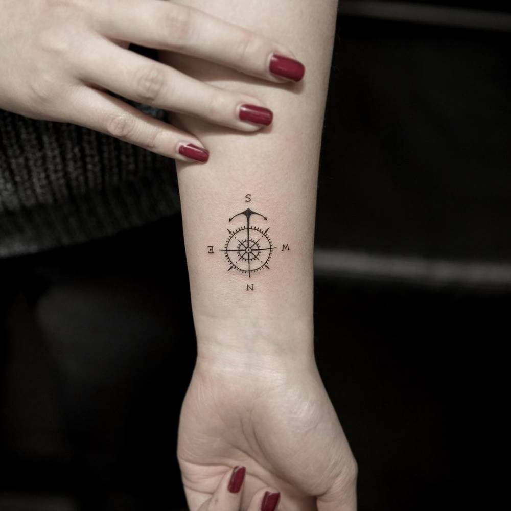 Tiny compass tattoo