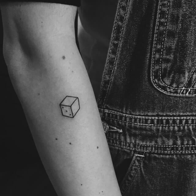 Tiny dice tattoo