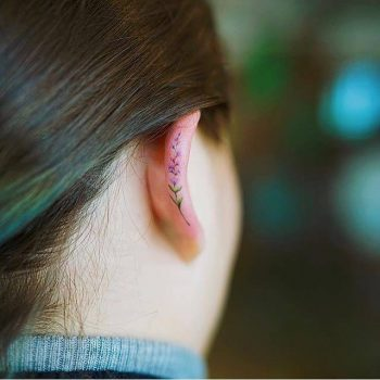 Tiny flower tattoo on the ear