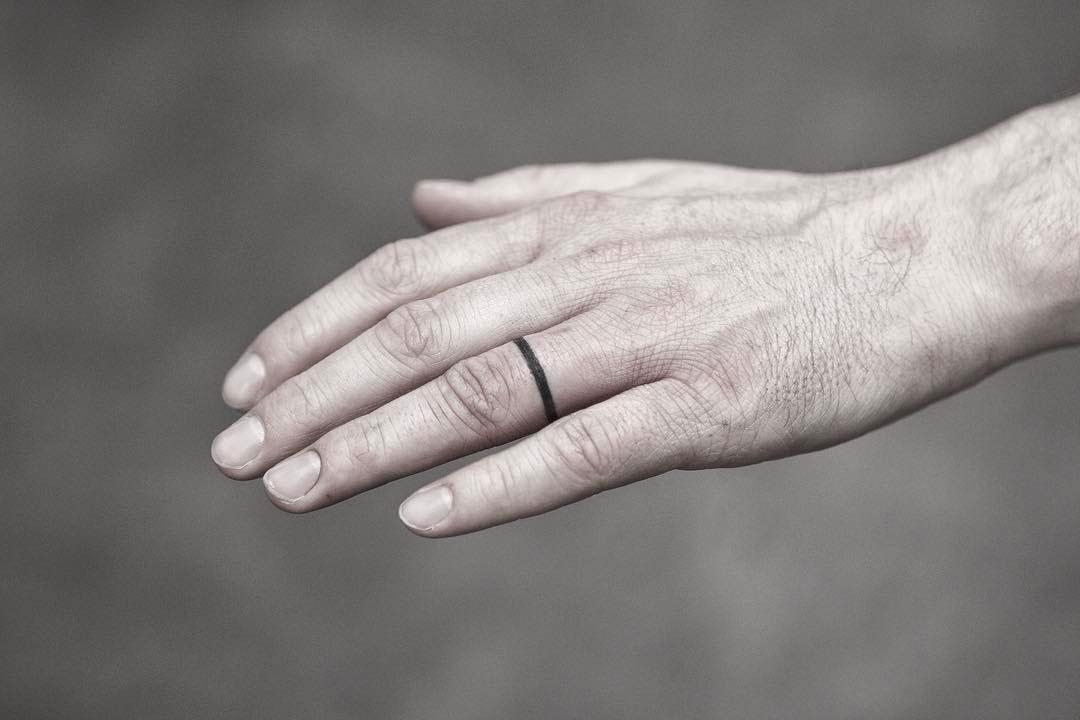 Tiny ring tattoo