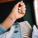 Tiny wave tattoo on the wrist