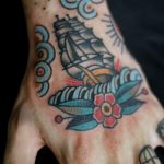 Traditional ship tattoo on the hand