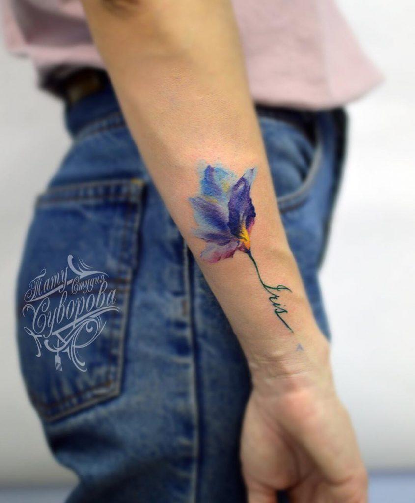 Violet flower tattoo
