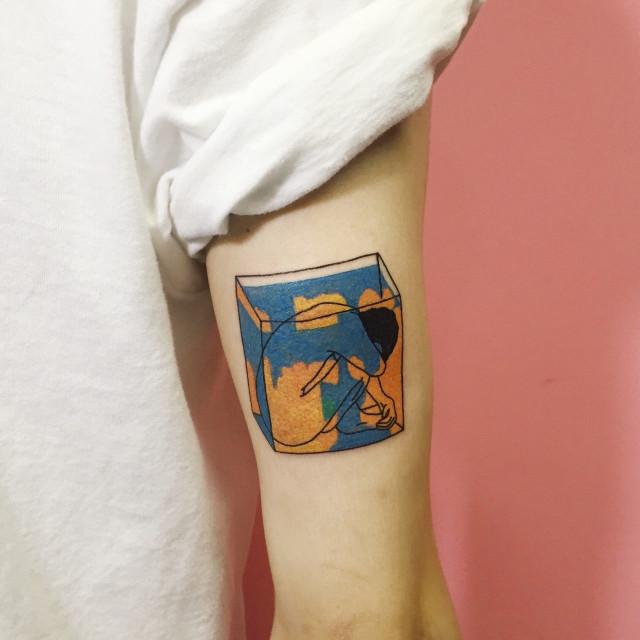 A man in a cube tattoo