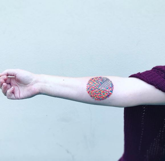 Abstract colorful circle tattoo