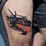 Abstract colorful tattoo on the thigh