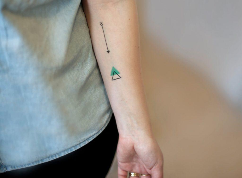Arrow and a triangle tattoo
