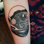 Astronaut helmet tattoo