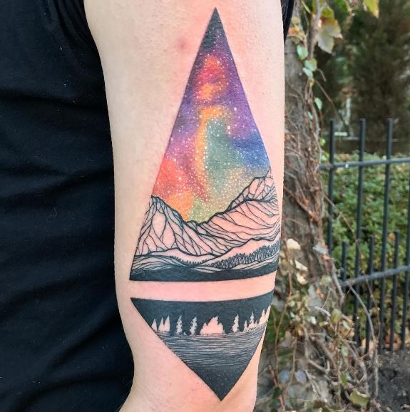 Aurora borealis in a triangle tattoo