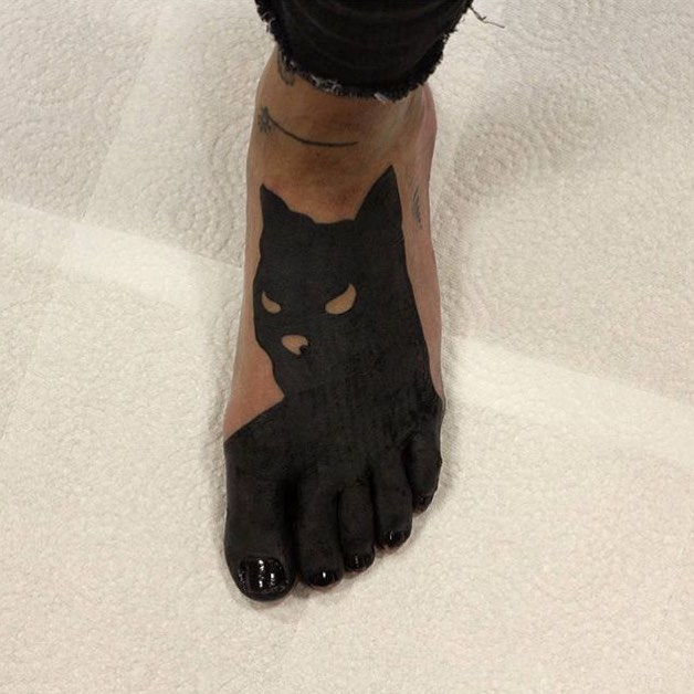 Batman tattoo on the foot