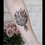 Beautiful black delicate flower bouquet tattoo