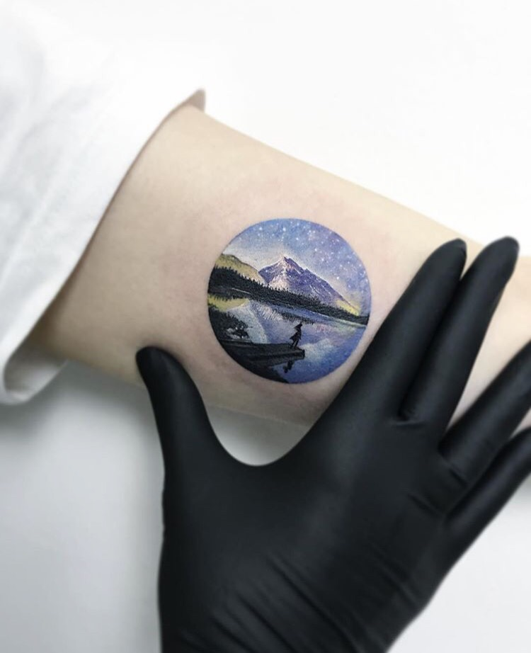 Beautiful circular landscape tattoo