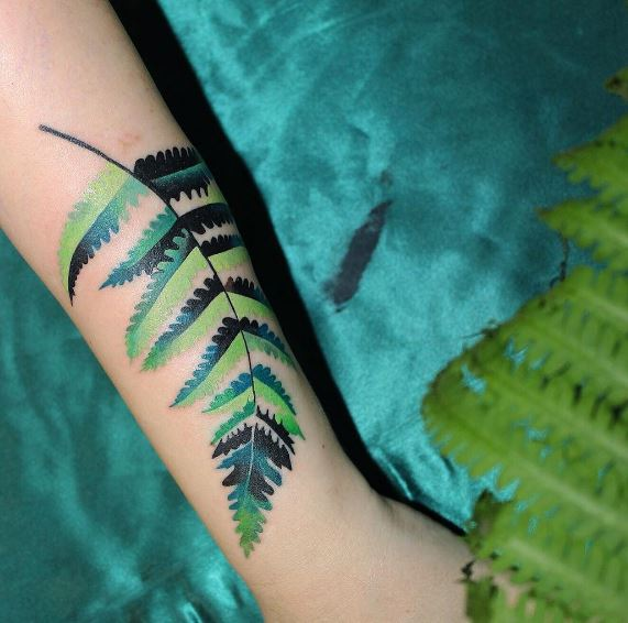 Beautiful green fern leaf tattoo