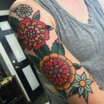 Beautiful traditional flowers sleeve tattoo