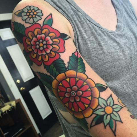 Beautiful traditional flowers sleeve tattoo