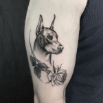 Black dobermann tattoo