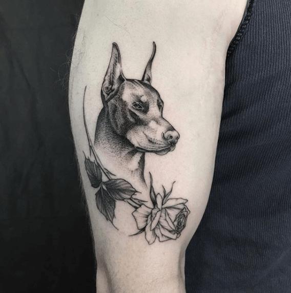 Black dobermann tattoo