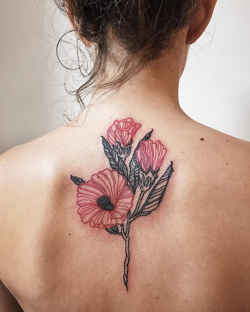 Black and red flower tattoo on the back