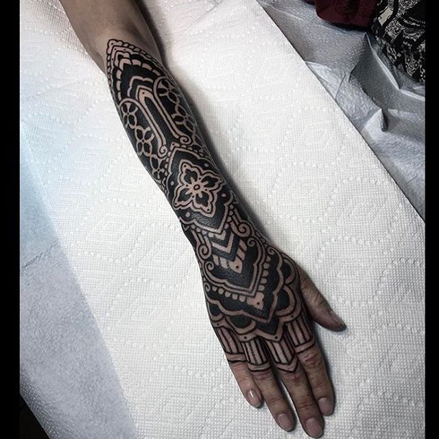 Black and white pattern tattoo on the arm