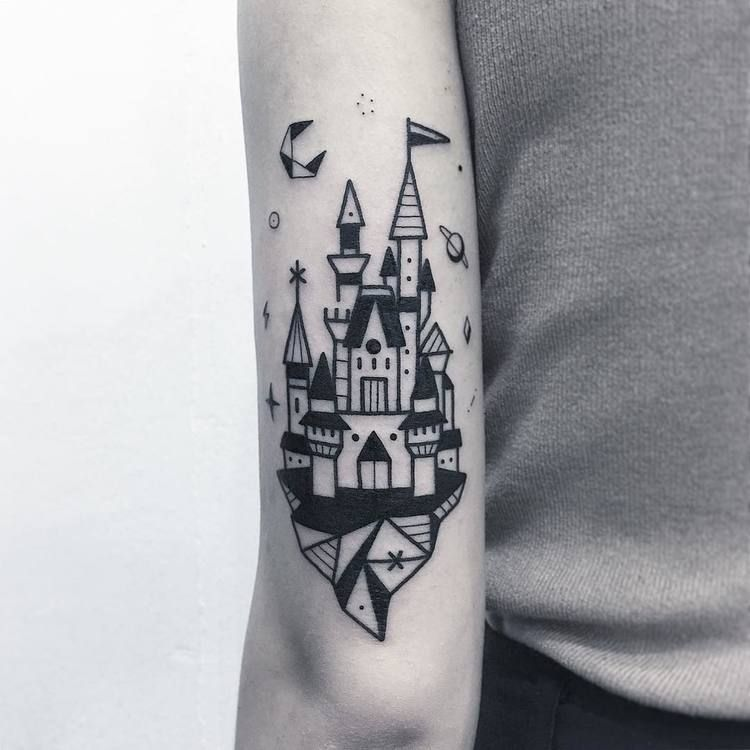 Black castle tattoo on the arm