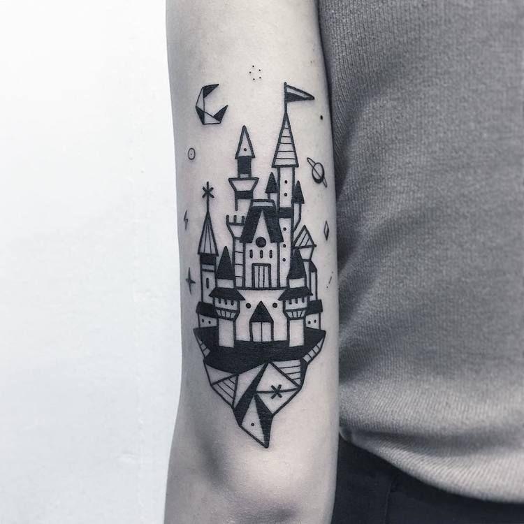 Black castle tattoo on the arm