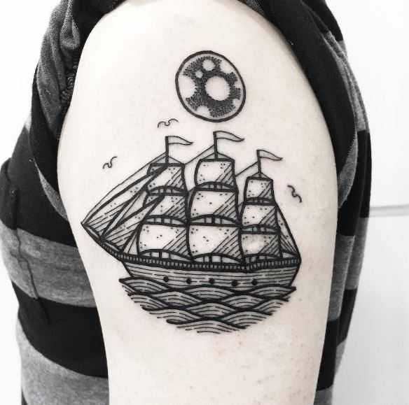 Black circular tattoo of a sailing vessel