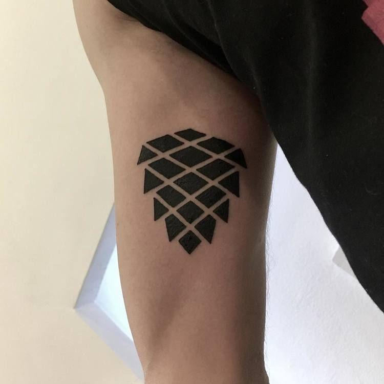 Black cone tattoo