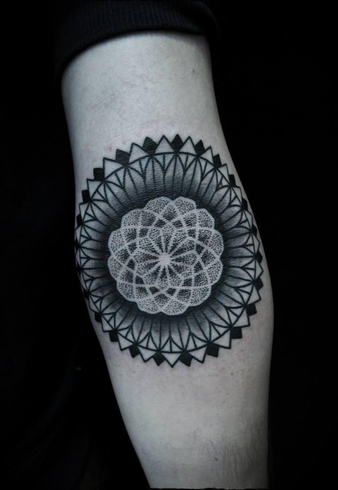 Black dot work mandala arm tattoo