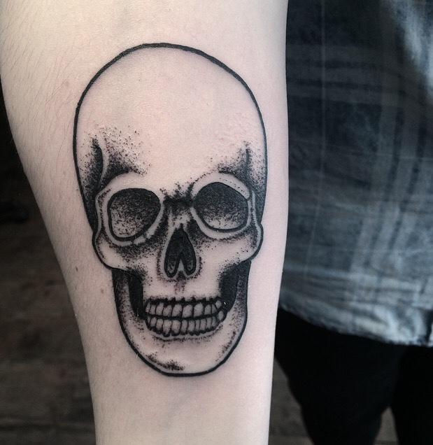 Black dotwork skull tattoo