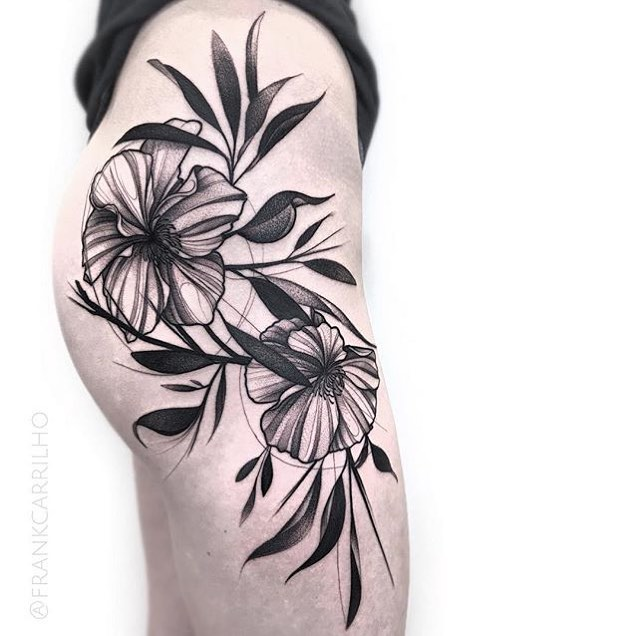 Black flower tattoo on the right hip and thigh