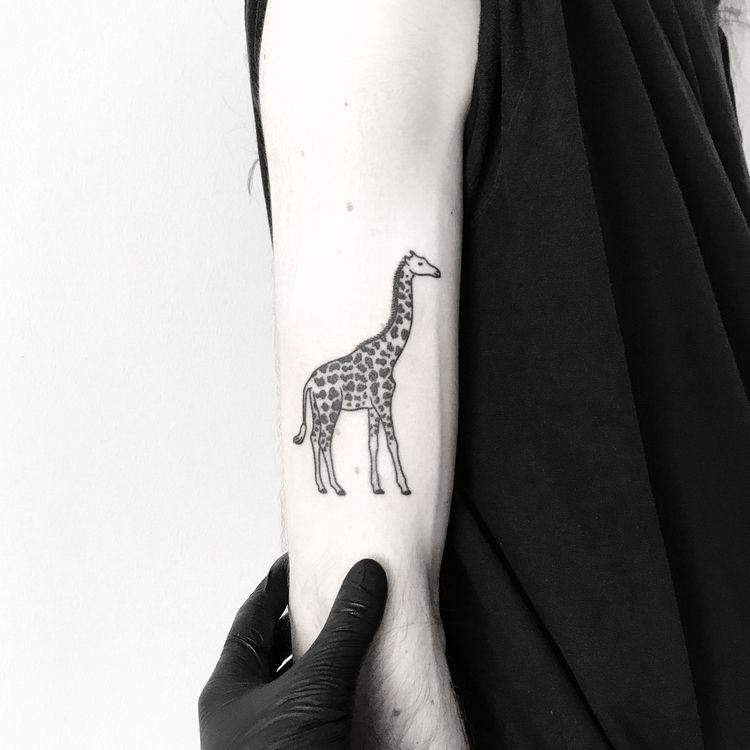 Black giraffe tattoo