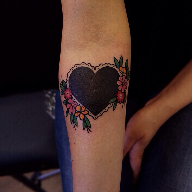 Black heart tattoo with flowers