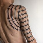Black linear sleeve tattoo