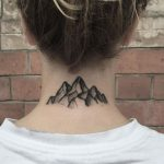 Black mountain tattoo on the back of the neck