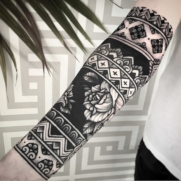 Black pattern sleeve tattoo