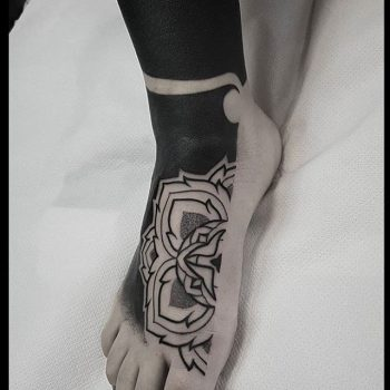 Black rose tattoo on the right foot