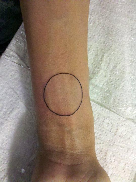 Black thin circle tattoo