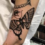 Black traditional butterfly tattoo