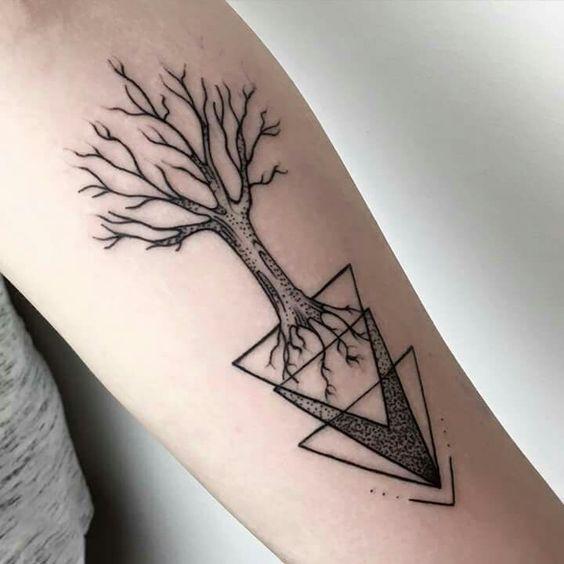 Black tree tattoo on the arm