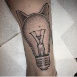 Cat head lightbulb tattoo